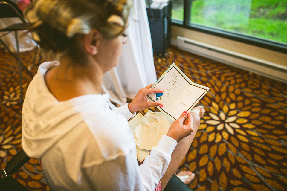 03 bride reading note - Lyuda + Tyler // Chicago Wedding Photographers