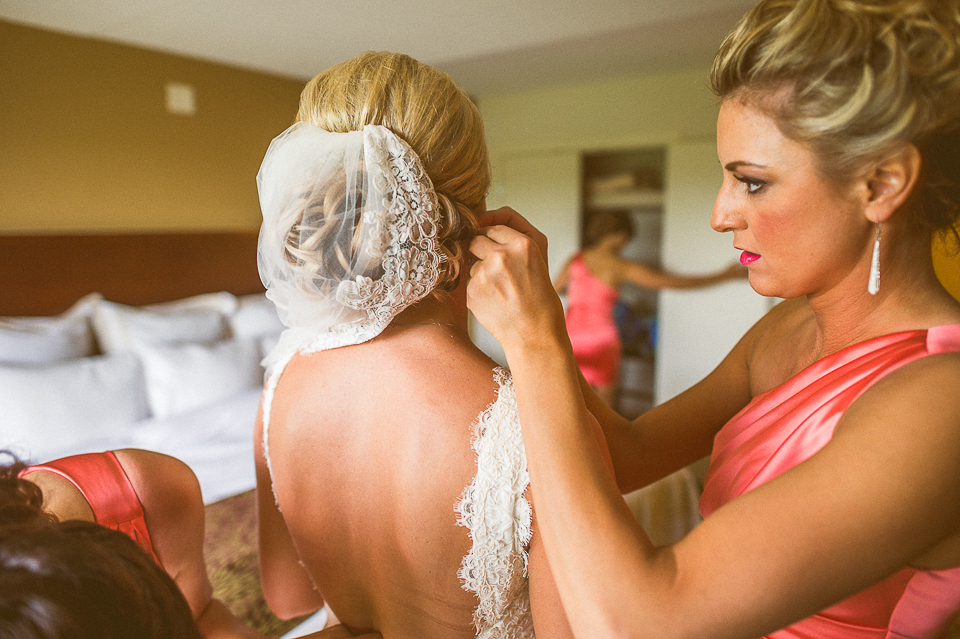 09 bride getting dressed - Lyuda + Tyler // Chicago Wedding Photographers