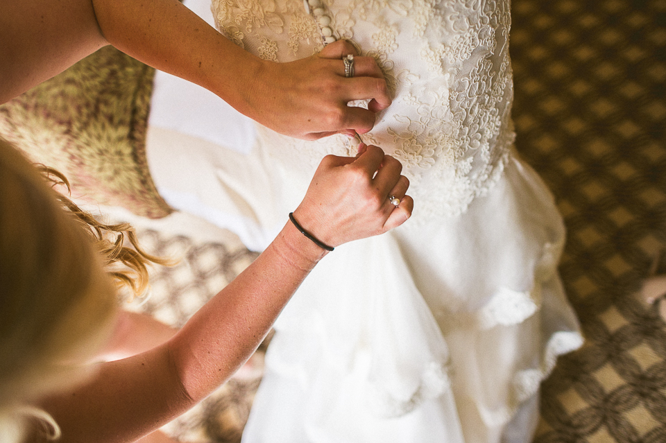 10 buttoning the dress - Lyuda + Tyler // Chicago Wedding Photographers