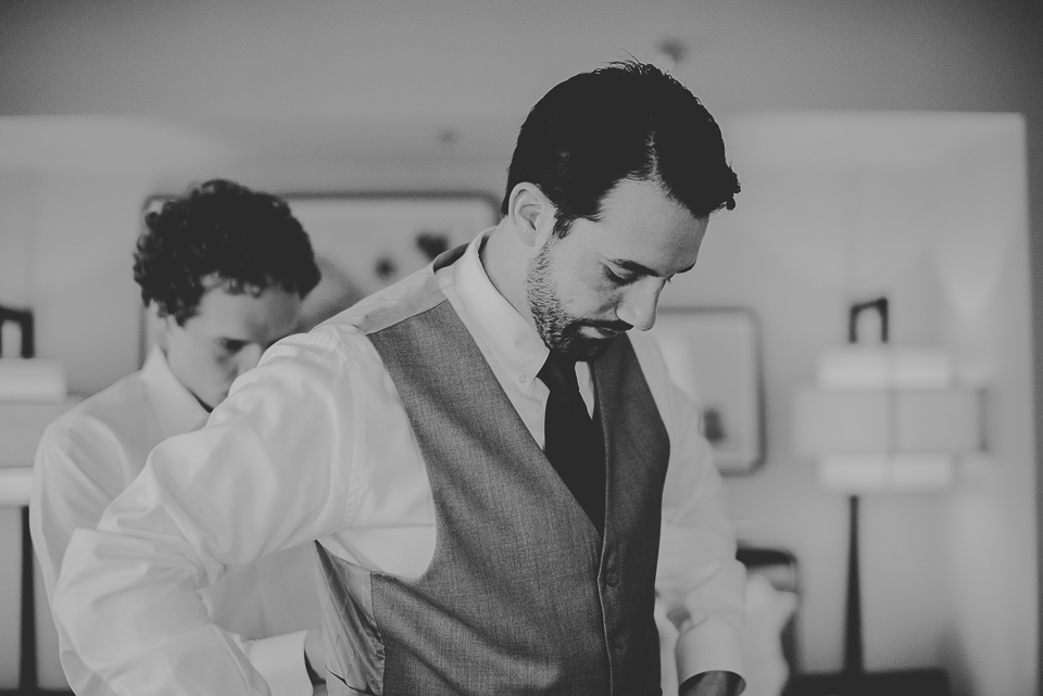 10 black and white groom getting ready