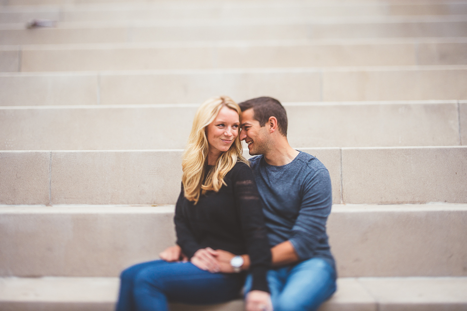 17 couple sitting at chicago riverwalk during engagement session