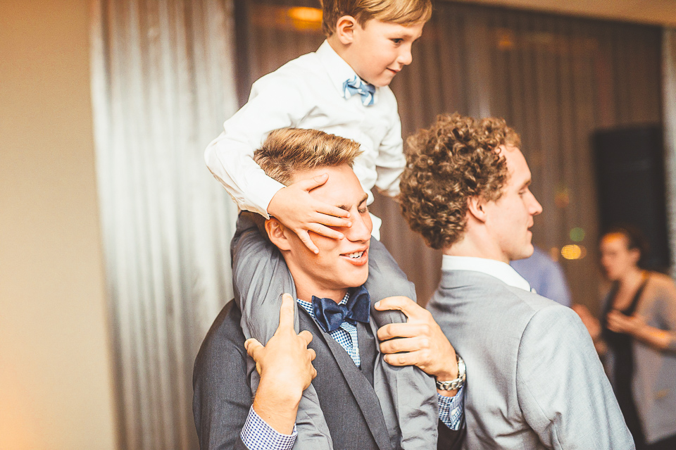 48 kid riding on shoulders