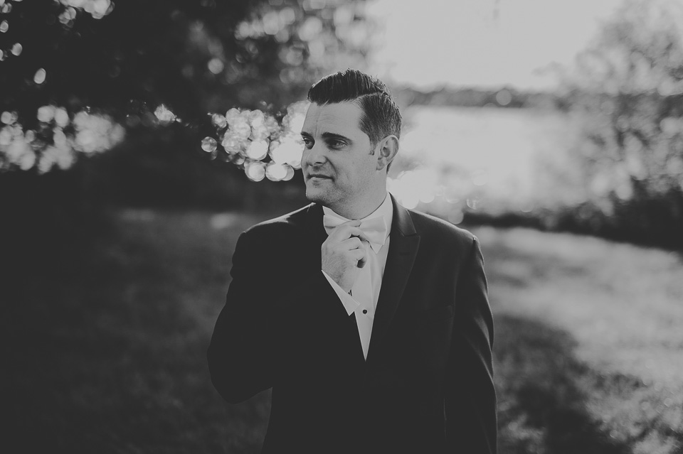 49 black and white groom portrait