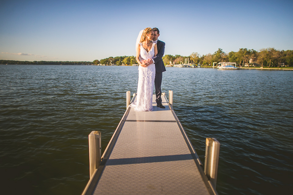55 wedding portraits on a pier in ceder lake