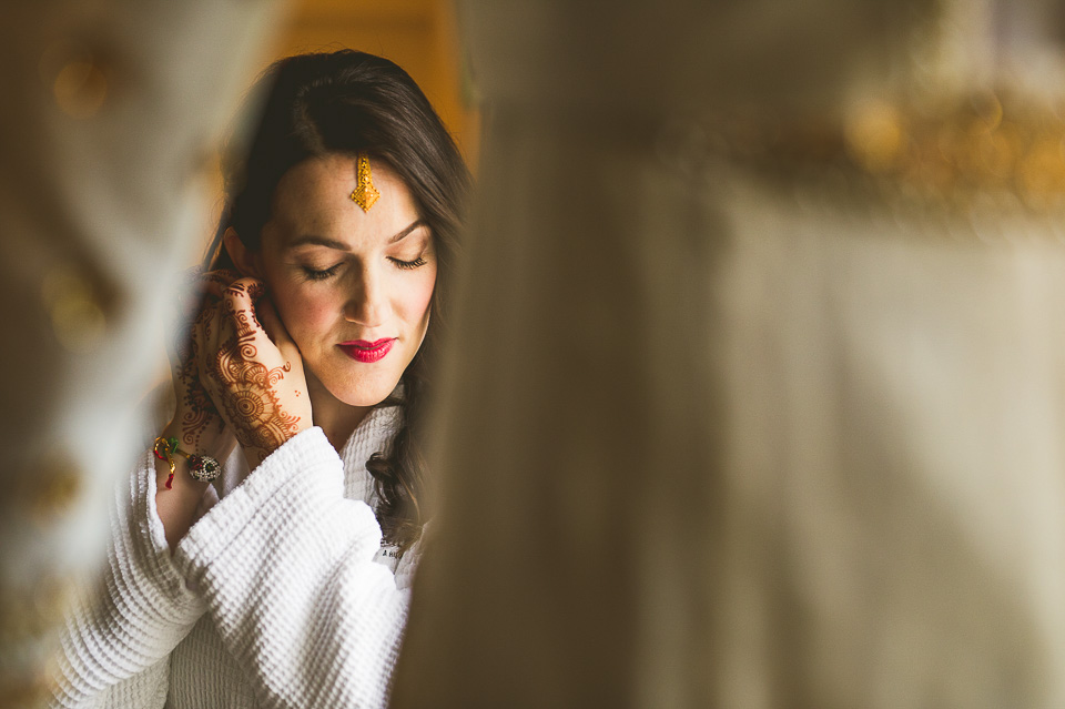 14 bride putting on earings - Molly + Simul // Chicago Wedding Photos at Bridgeport Art Center