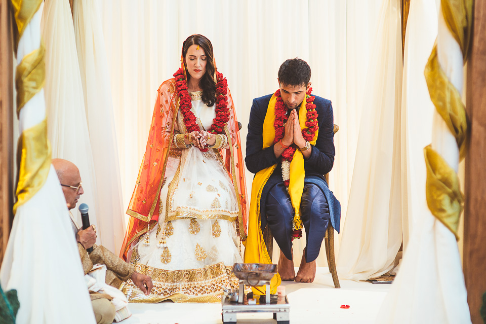 61 praying at hindu ceremony - Molly + Simul // Chicago Wedding Photos at Bridgeport Art Center