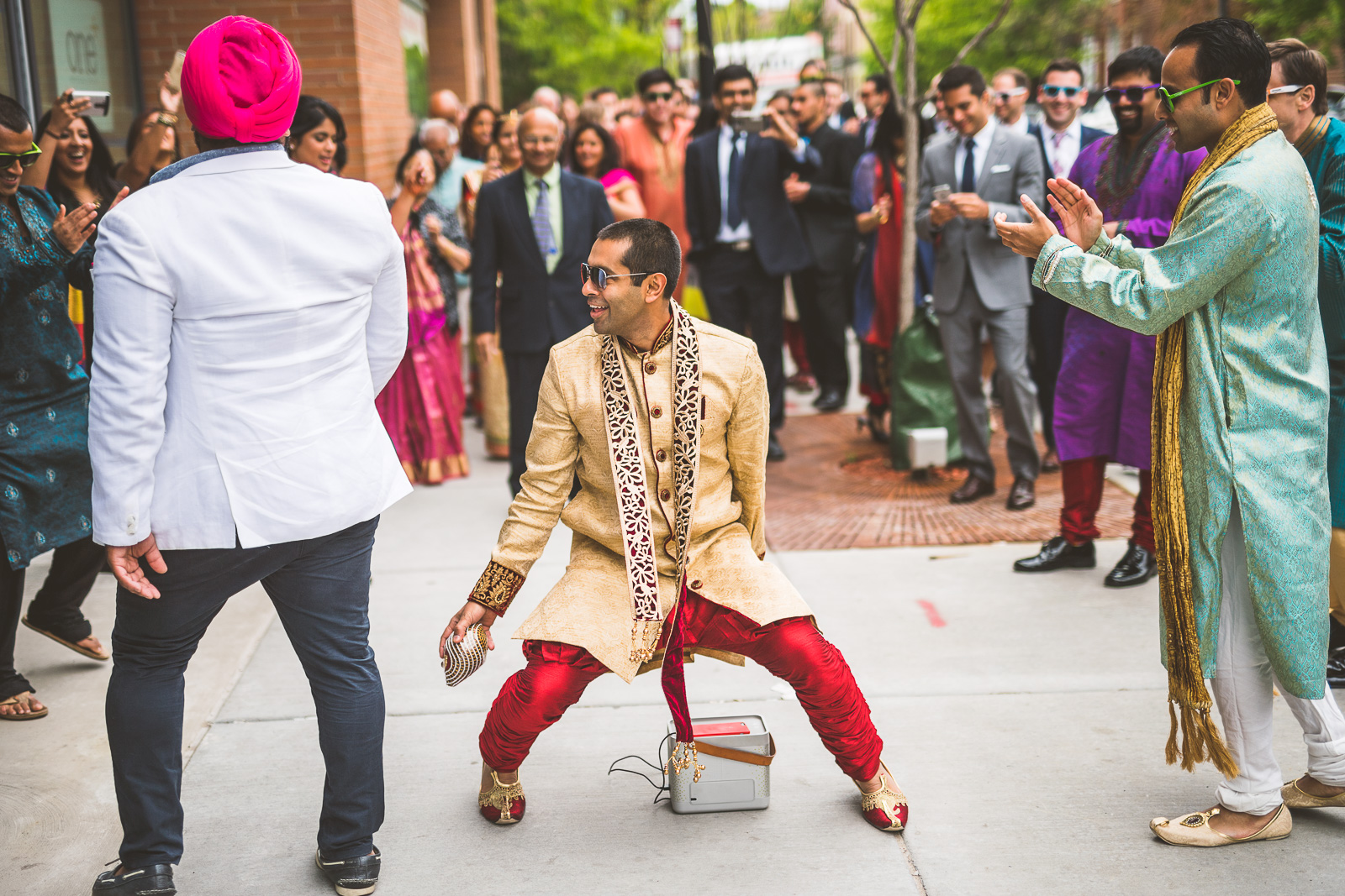 25 groom dancing duing barat - Jackie + Raj // Chicago Wedding Photography at Floating World Gallery