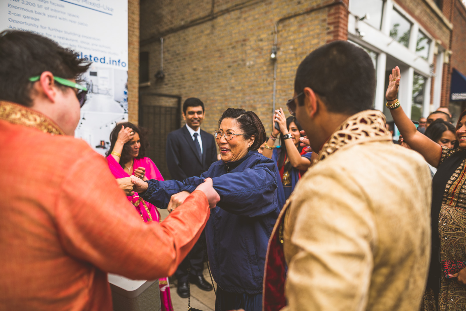 26 mother of bride dancing - Jackie + Raj // Chicago Wedding Photography at Floating World Gallery