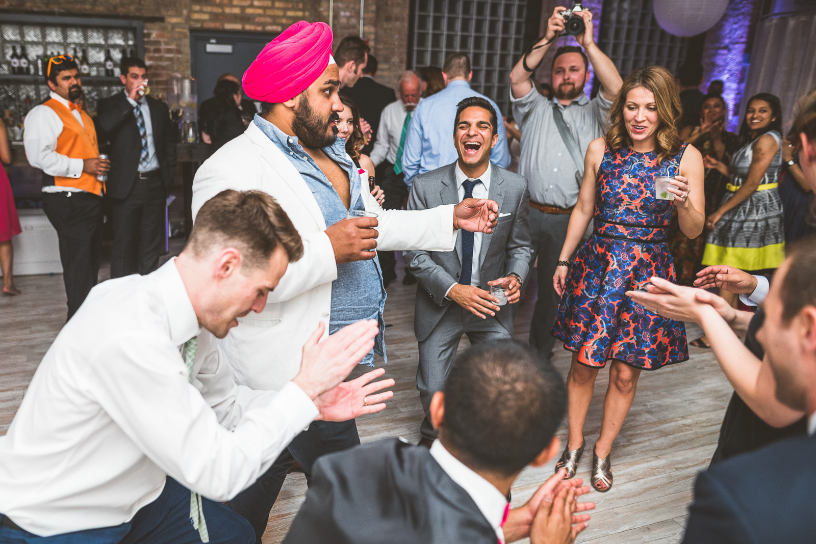 66 dancing at reception - Jackie + Raj // Chicago Wedding Photography at Floating World Gallery