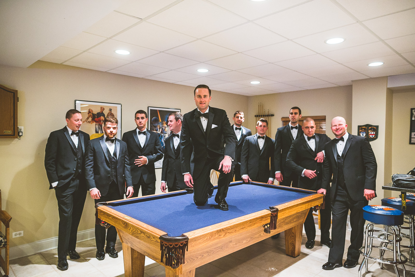 20 groomsmen on pool table