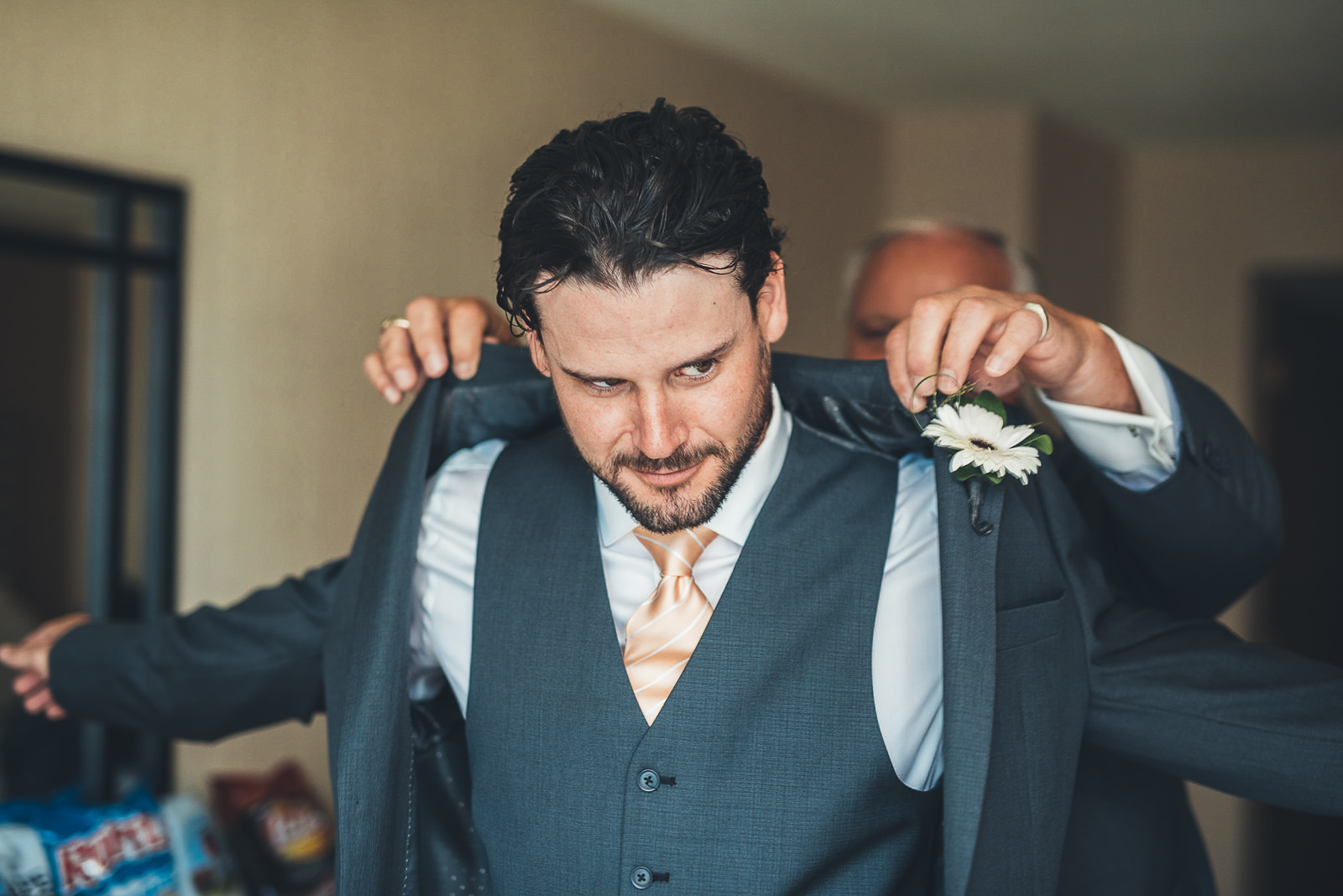 14 groom getting dressed