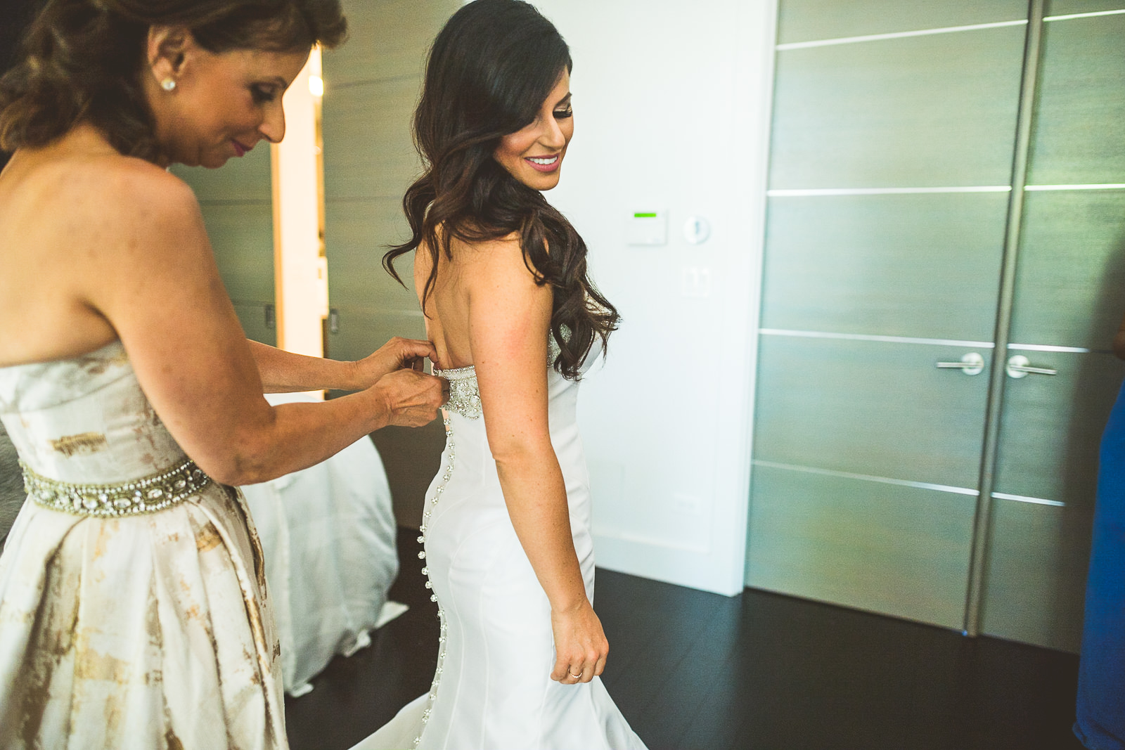 20 bride putting on dress