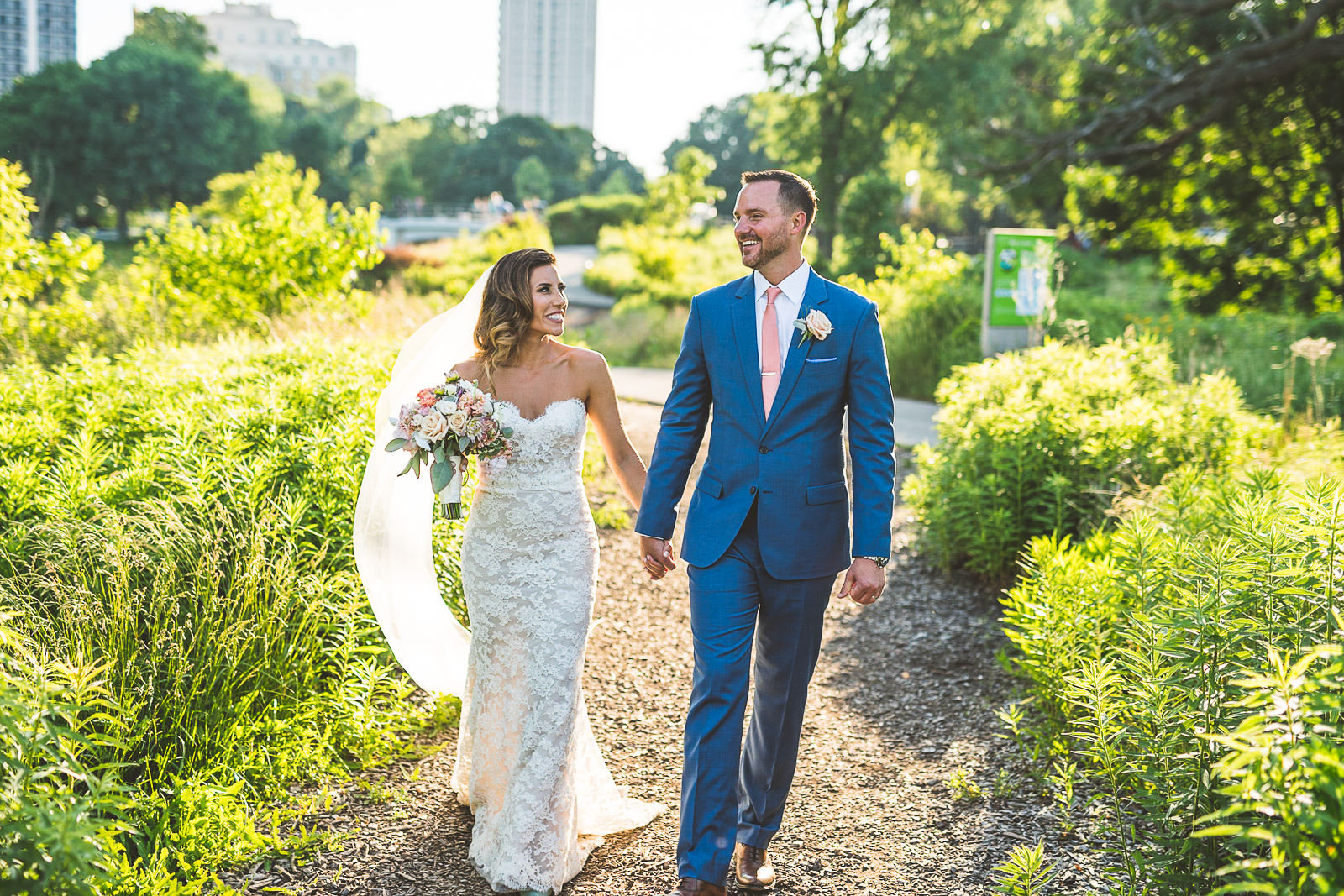 36 bride and groom walking around park - Natalie + Alan // Chicago Wedding Photographer at Cafe Brauer
