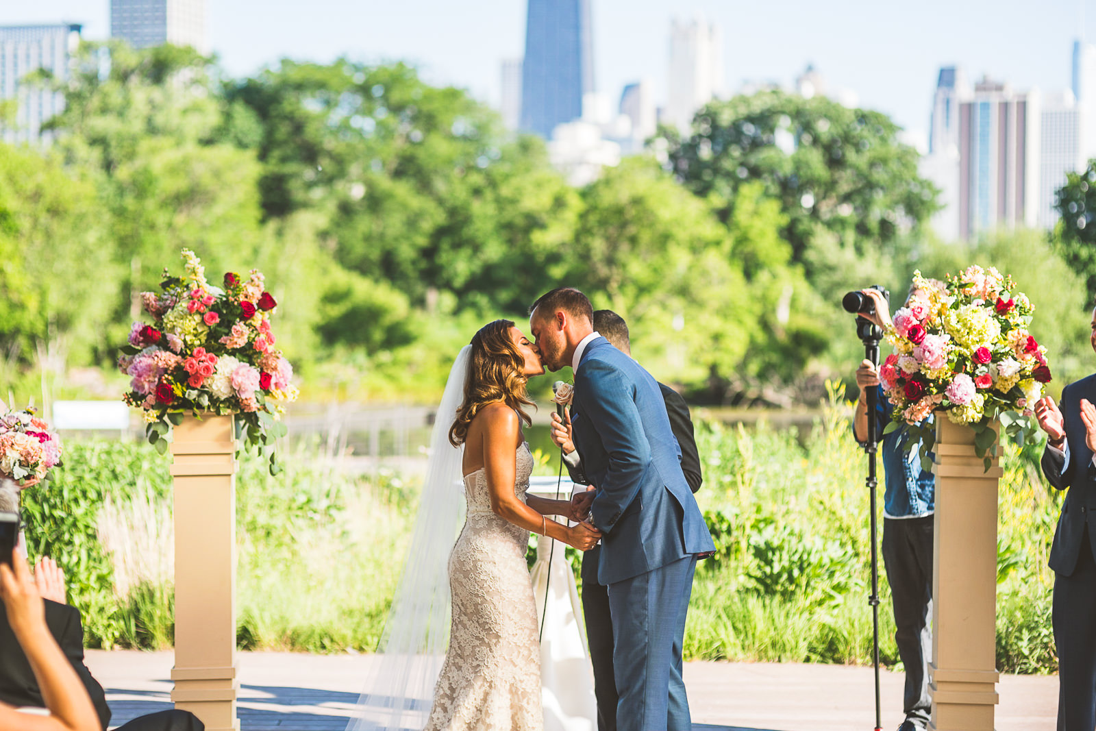 47 first kiss - Natalie + Alan // Chicago Wedding Photographer at Cafe Brauer
