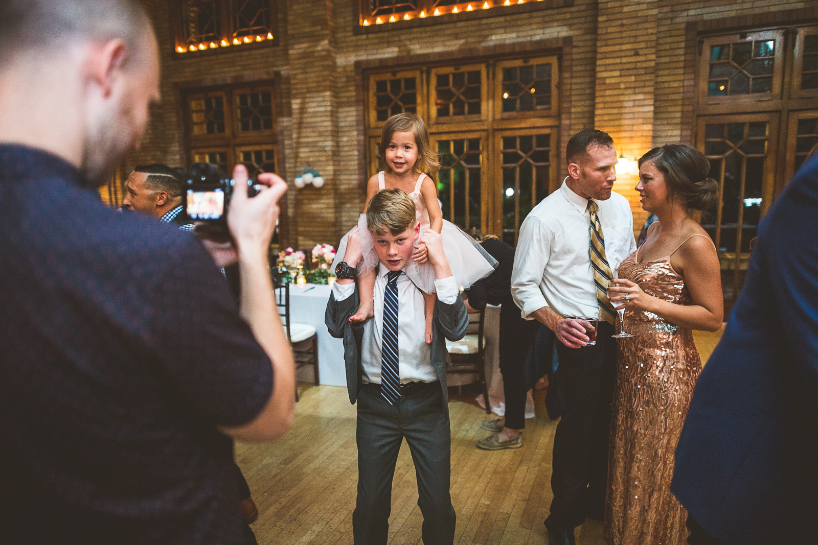 70 on shoulders - Natalie + Alan // Chicago Wedding Photographer at Cafe Brauer