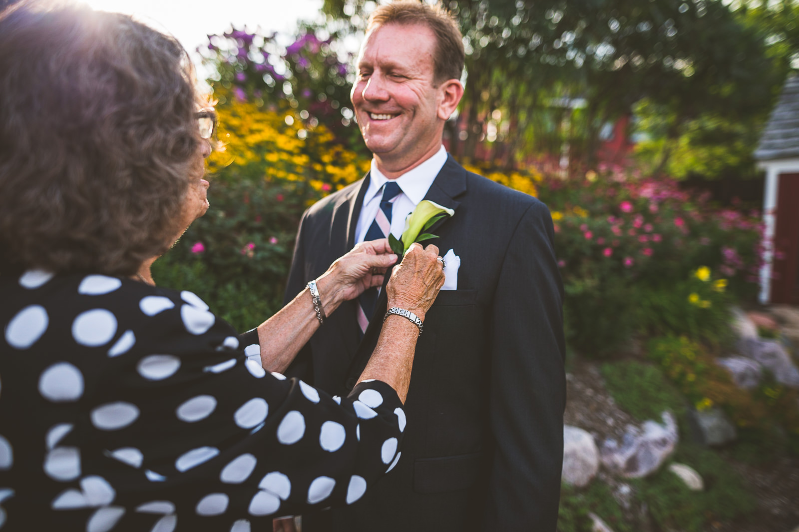 11 put on flower on groom - Karen + Scott // Fishermens Inn Wedding Photographer Elburn Illinois