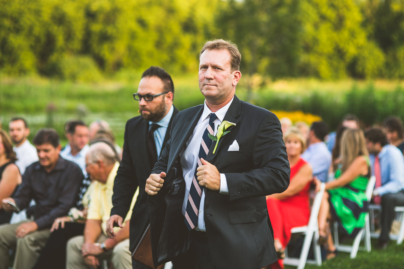 21 groom walking down isle - Karen + Scott // Fishermens Inn Wedding Photographer Elburn Illinois