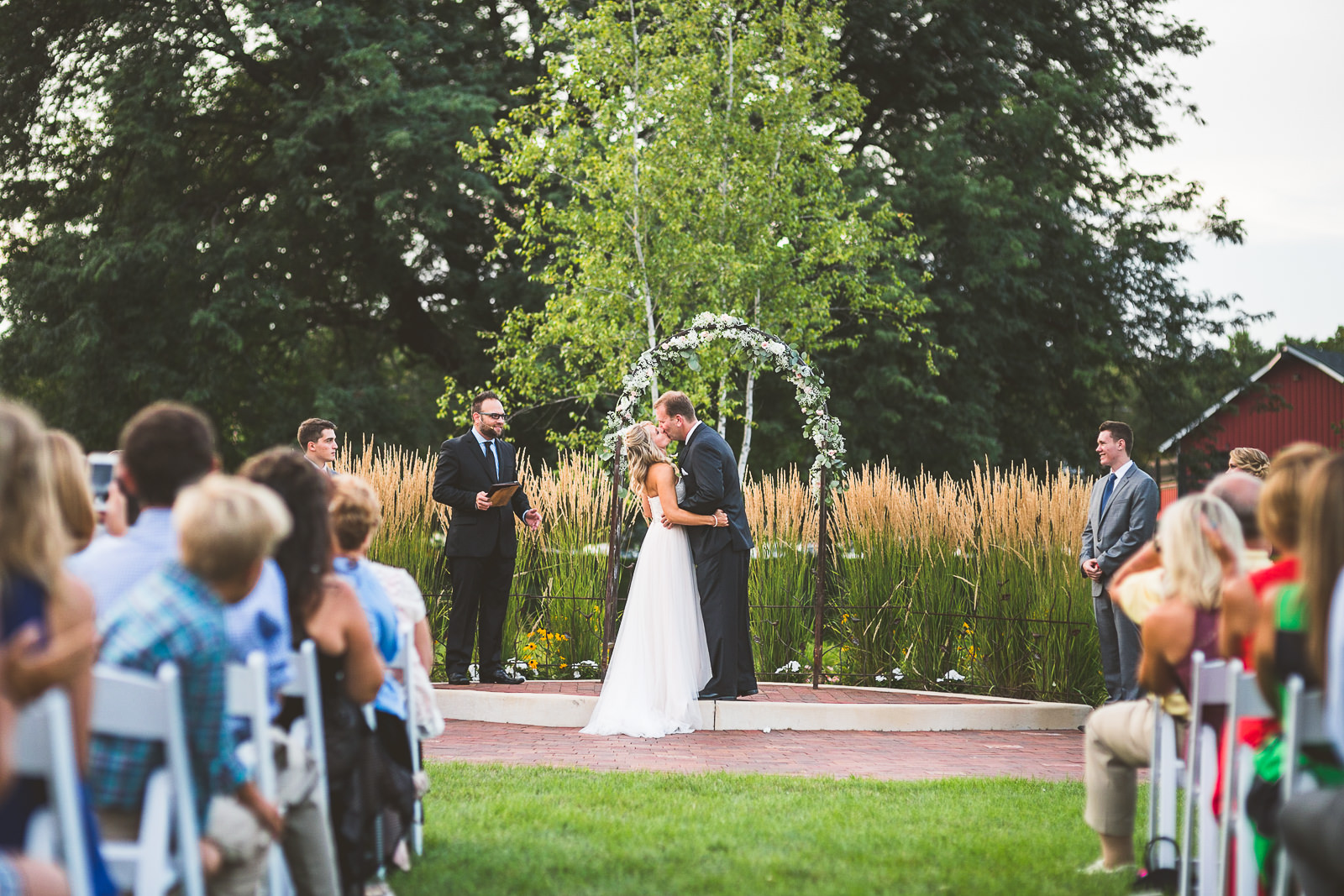 44 first kiss at wedding - Karen + Scott // Fishermens Inn Wedding Photographer Elburn Illinois