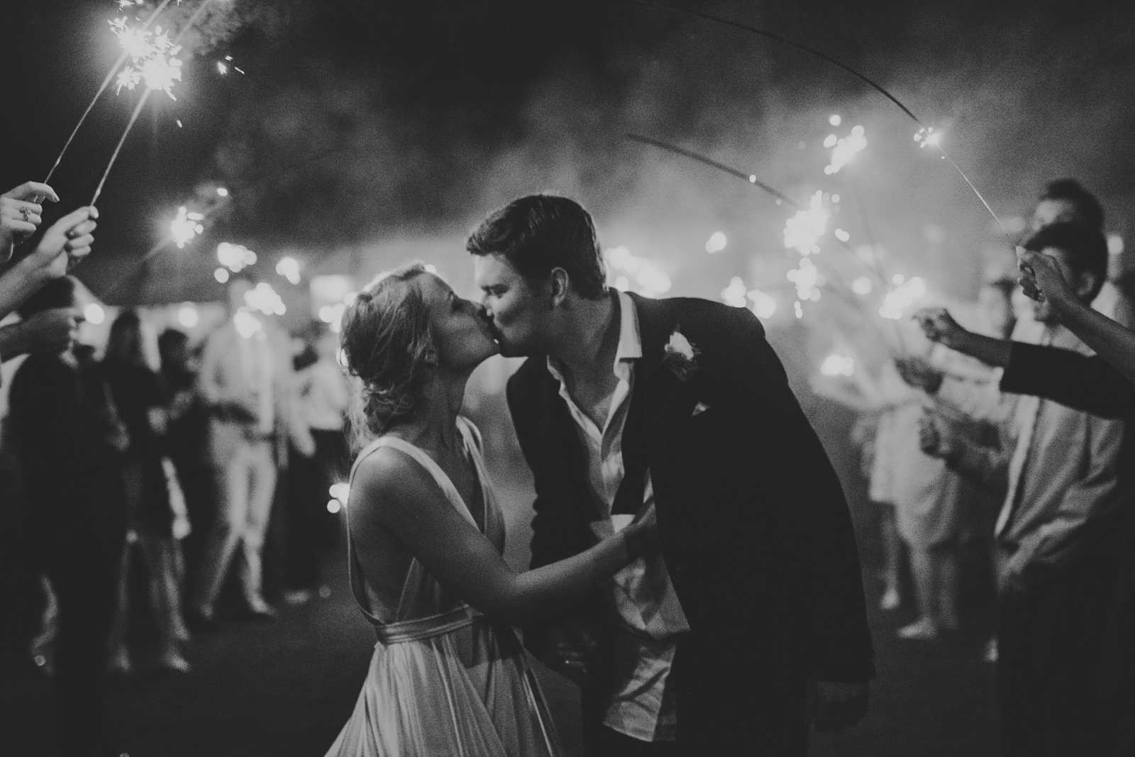 106-bride-and-groom-kiss-at-sparkler-exit