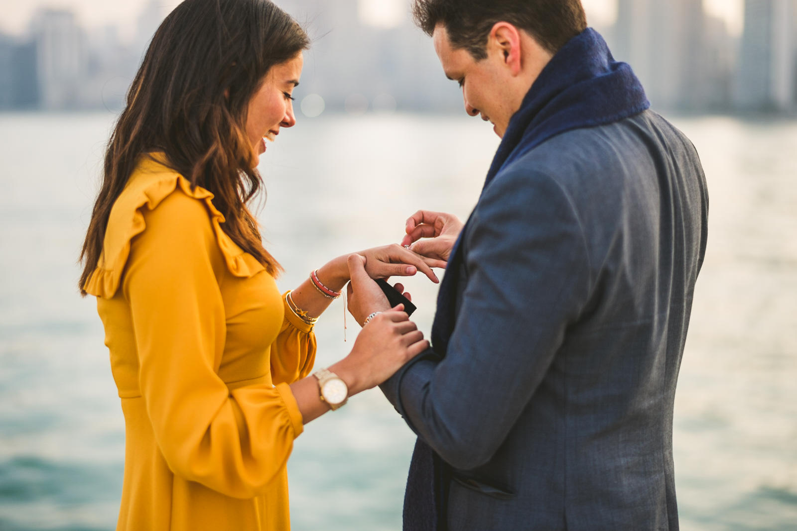08 putting the ring on in chicago - Geraldine + Jose // Proposing in Chicago