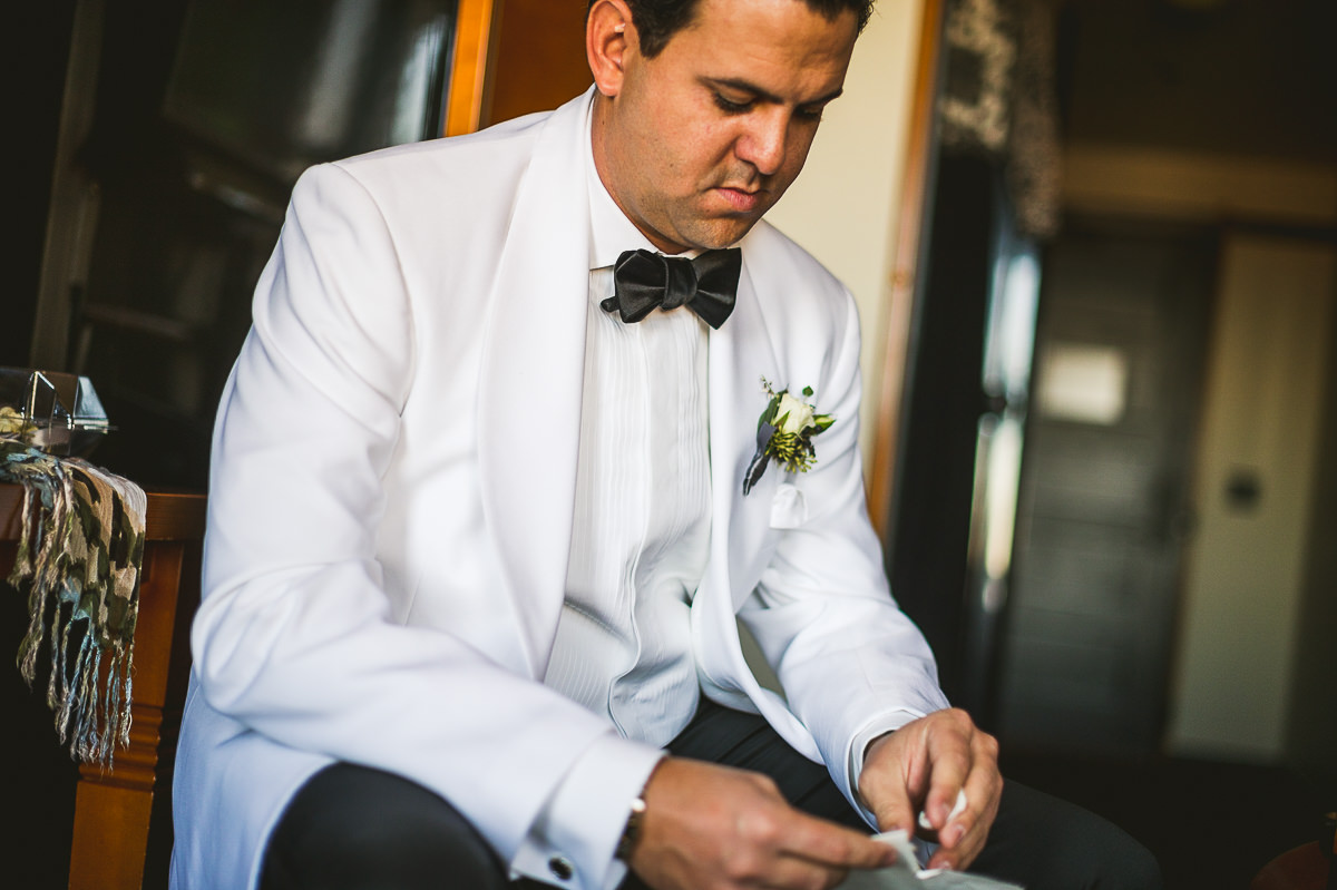 10 chicago wedding photography groom reading letter - Chicago Wedding Photography at Chicago Athletic Association // Alicia + Spencer