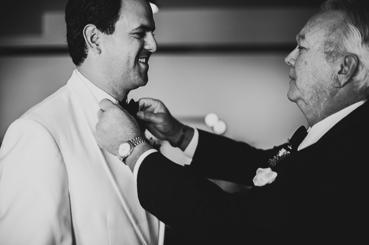 12 groom fixing tie - Chicago Wedding Photography at Chicago Athletic Association // Alicia + Spencer