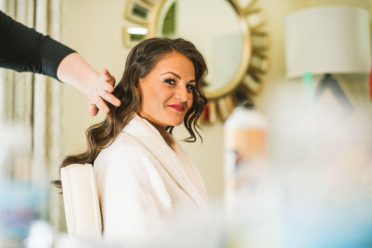 14 bride getting makeup done - Chicago Wedding Photography at Chicago Athletic Association // Alicia + Spencer