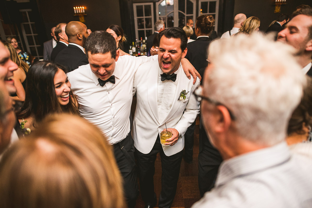 79 groom laughing at his wedding - Chicago Wedding Photography at Chicago Athletic Association // Alicia + Spencer