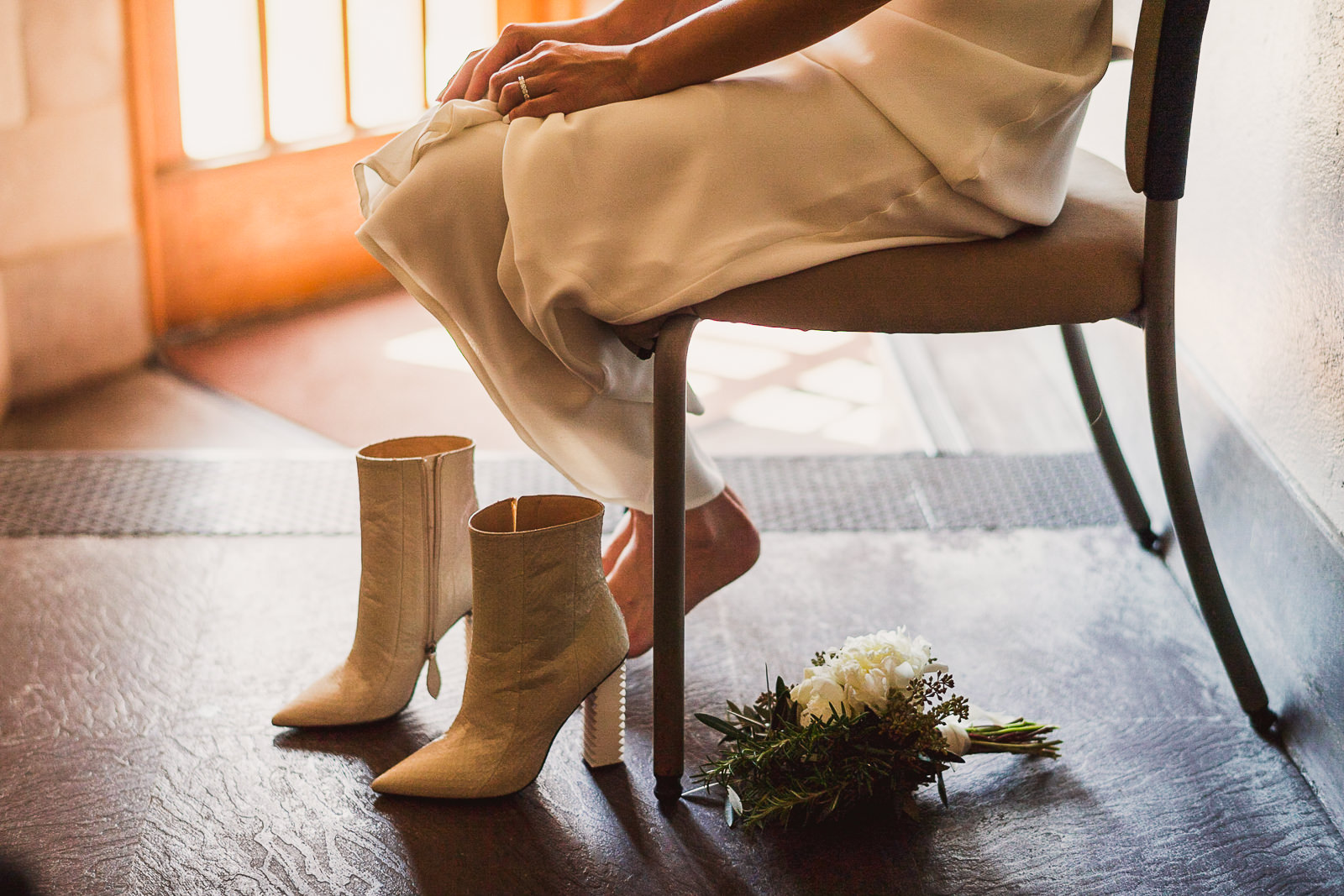 12 bride putting on wedding shoes - Rebecca + Doha // Wedding Photos at Room 1520 Chicago