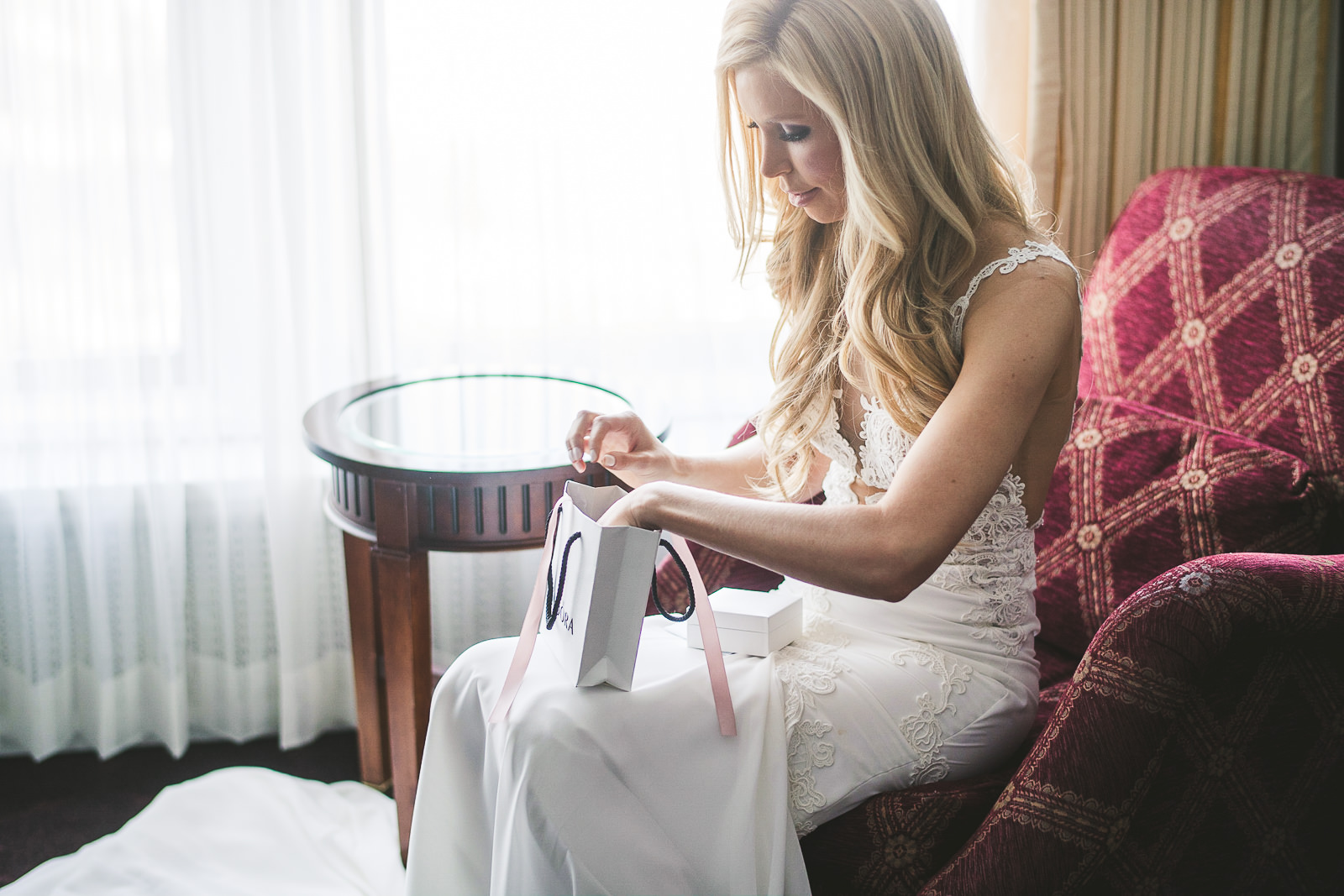16 bride opening gift - Kayla + Terry // Drake Hotel Chicago Wedding Photos