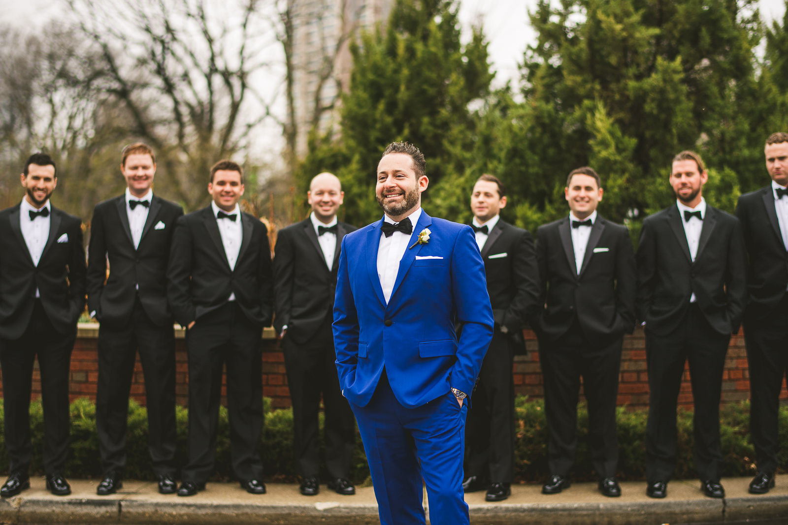 30 groomsmen posing at wedding - Chicago Wedding Photography at Gallery 1028 // Courtnie + David