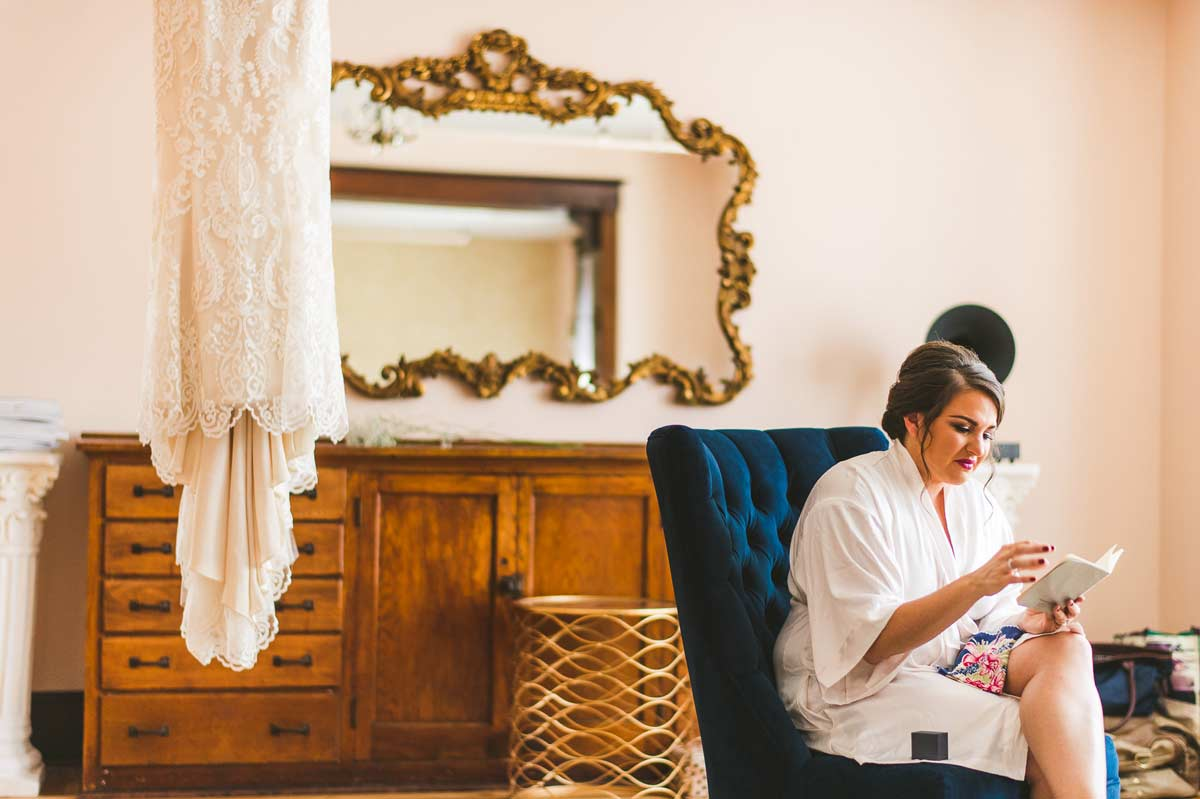 07 bride reading letter touching moment - Cantigny Wedding Photos