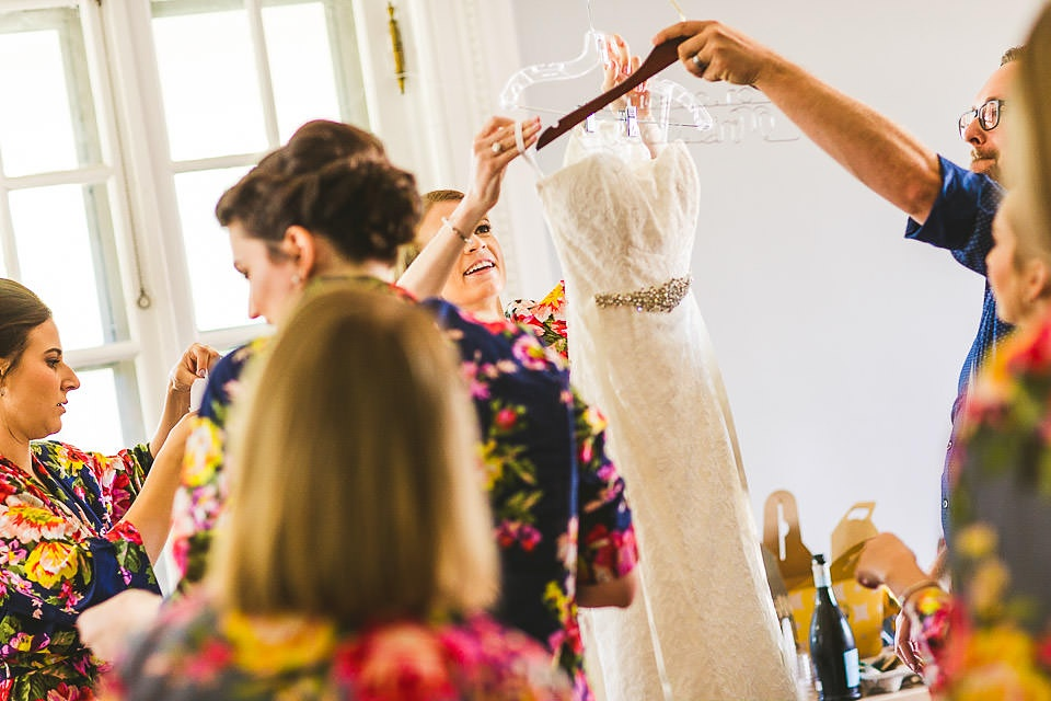 07 bridesmaids getting the dress.jpg