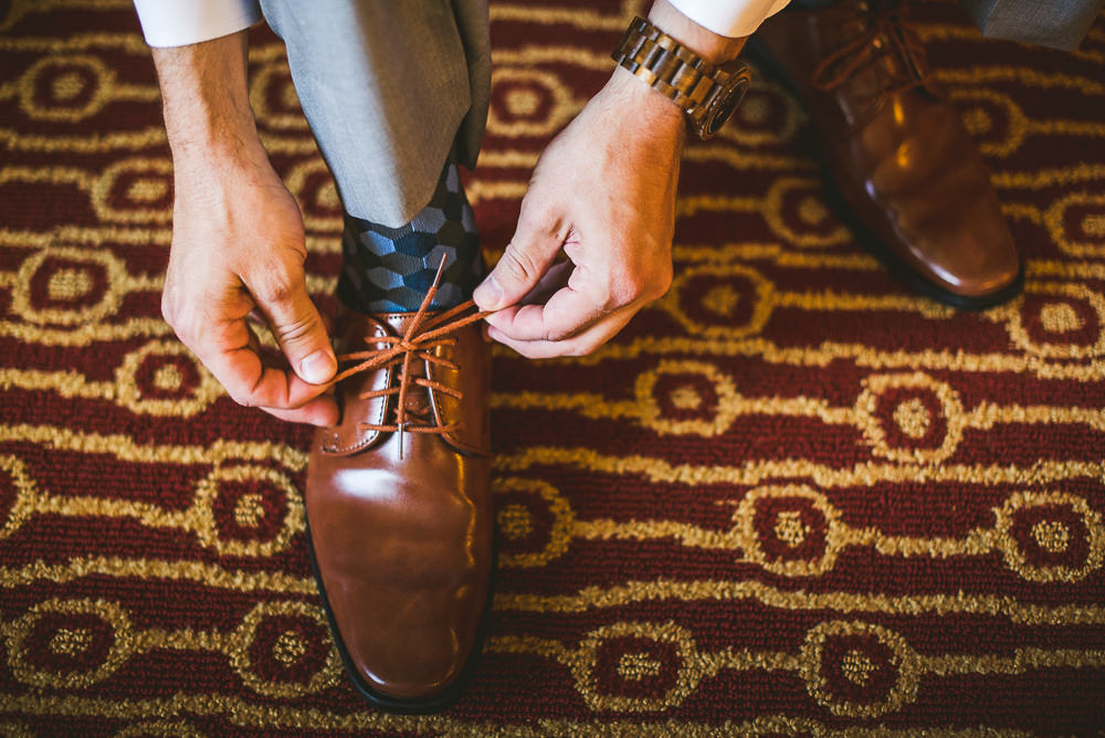 13 groom tieing shoes - Haight Wedding Photography // Kelly + Charlie