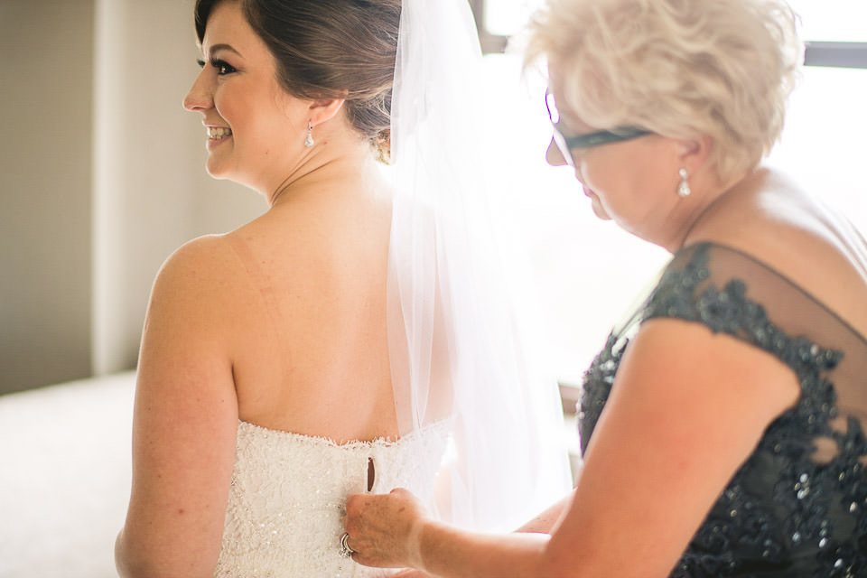 14 mom zipping up brides dress - Harold Washington Library Wedding Photos // Kasia + Chris