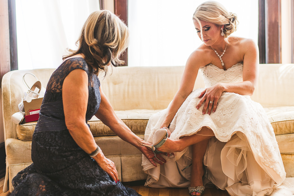 18 bride putting on shoes at the haight - Haight Wedding Photography // Kelly + Charlie