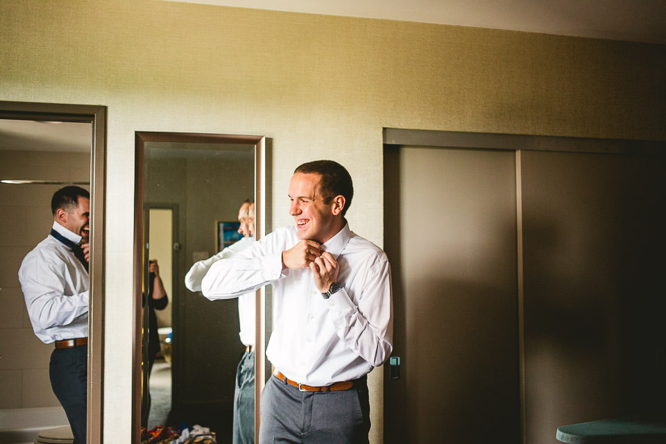 19 groom getting dressed photos - Harold Washington Library Wedding Photos // Kasia + Chris