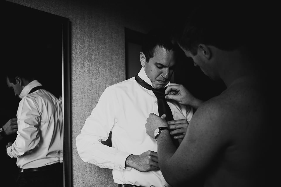 20 groom getting dressed - Harold Washington Library Wedding Photos // Kasia + Chris