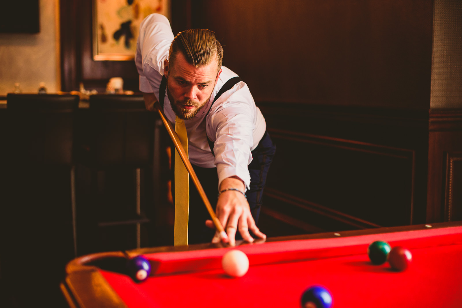 10 groom playing pool at hilton on michigan avenue - Hilton Chicago Wedding Photographer // Sarah + Aaron