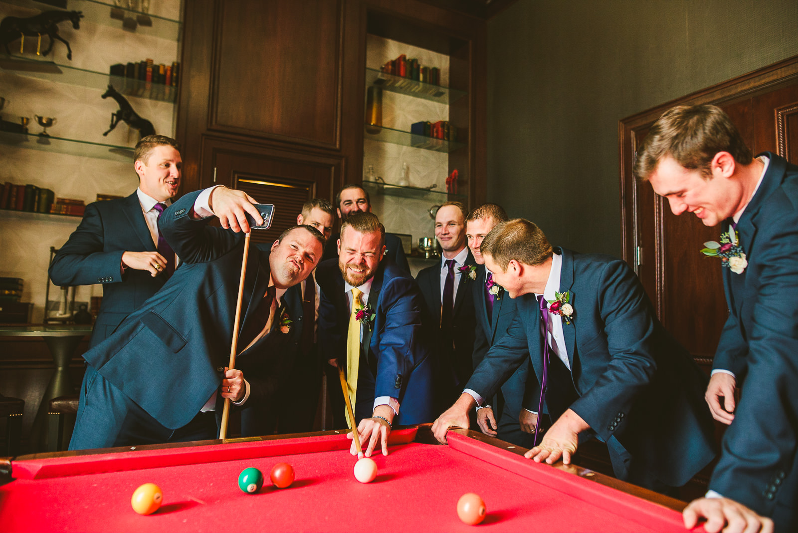 16 groom and groomsmen having fun at hilton wedding - Hilton Chicago Wedding Photographer // Sarah + Aaron