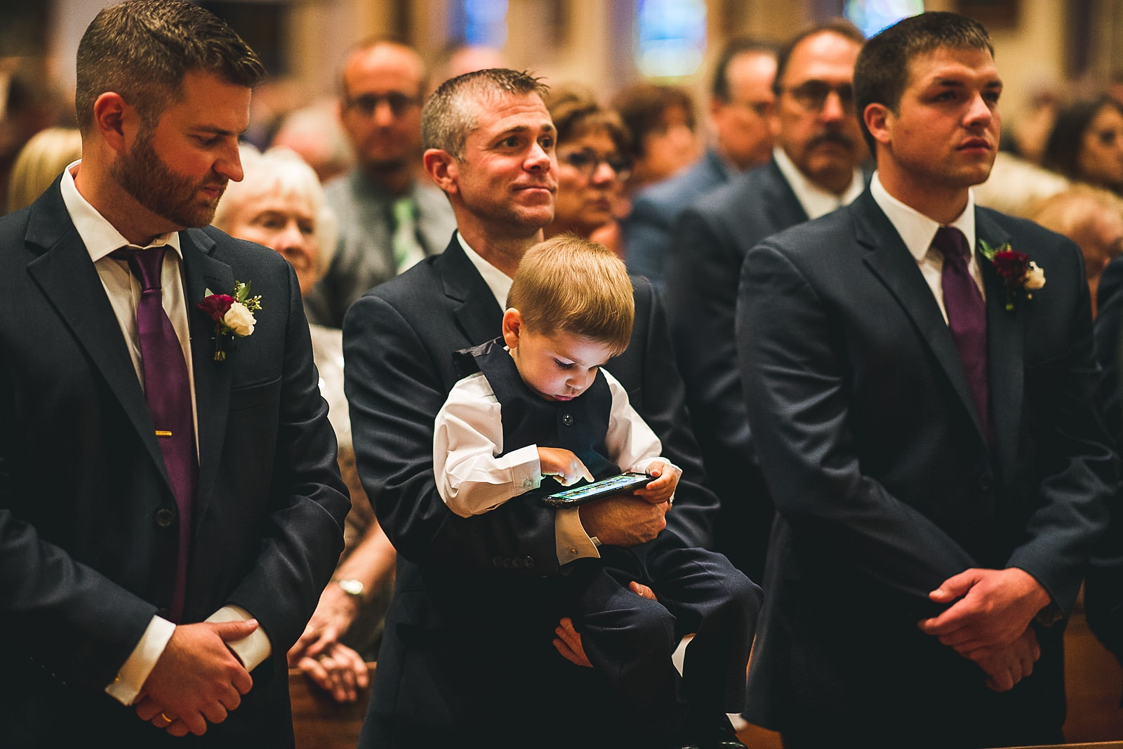 34 kid on an ipad at holy name - Hilton Chicago Wedding Photographer // Sarah + Aaron