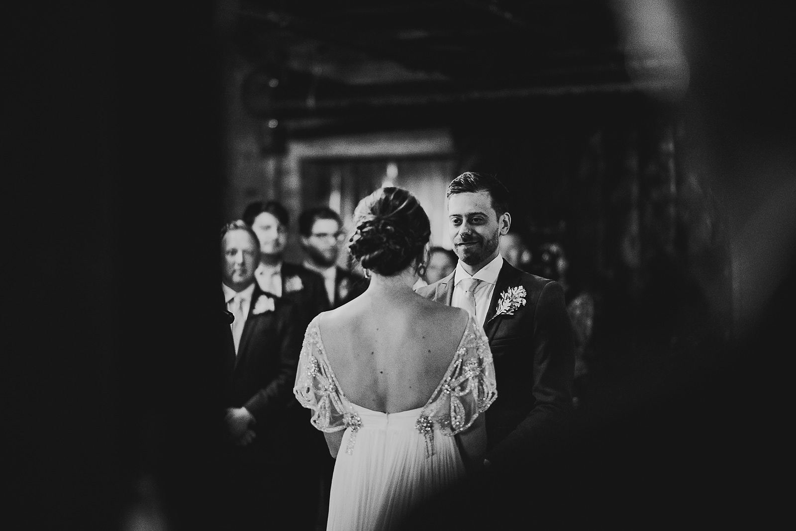 30 bride and groom at salvage one alter - Salvage One Wedding // Pearl + Ken