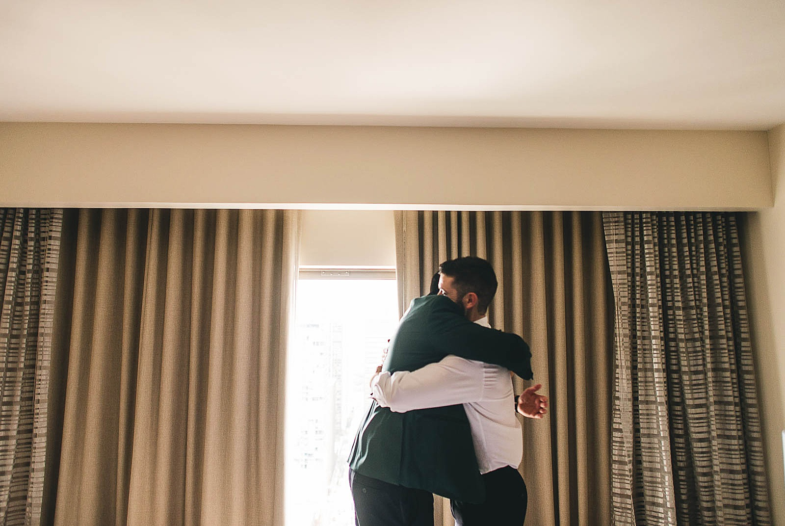 10 groom hugging best man photo - Ivy Room Chicago Wedding Photos // Bethany + Anthony