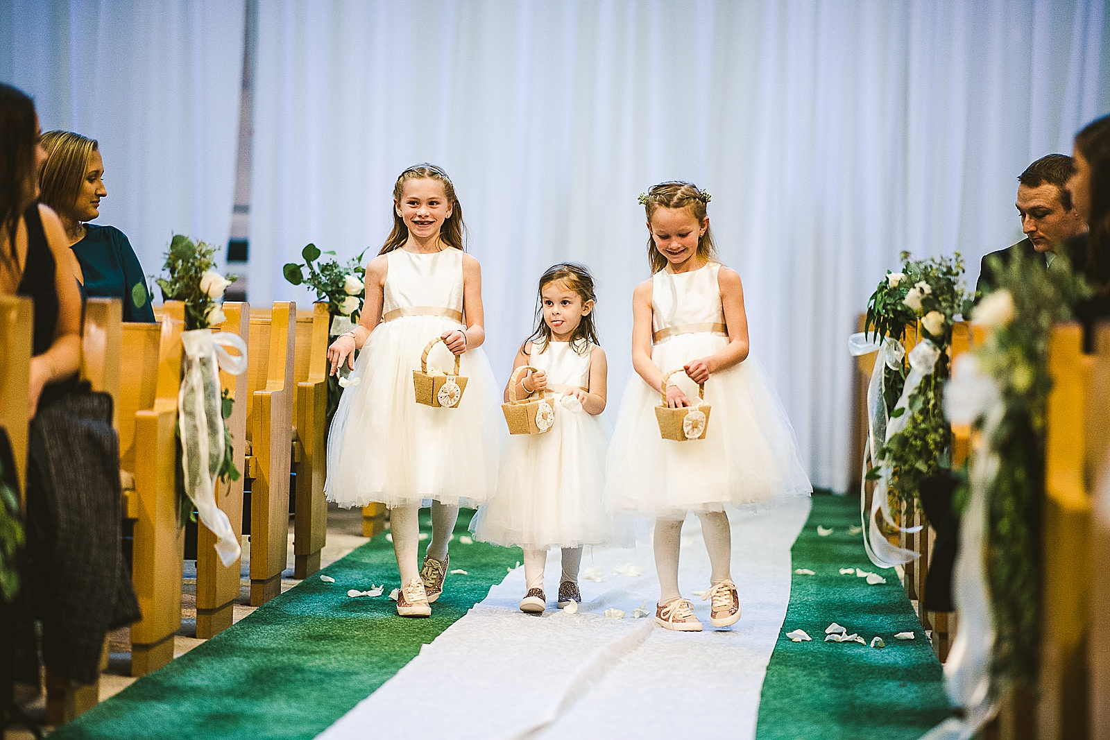 22 flower girls waking down the aisle - The Glen Club Wedding Photos // Katie + Nick