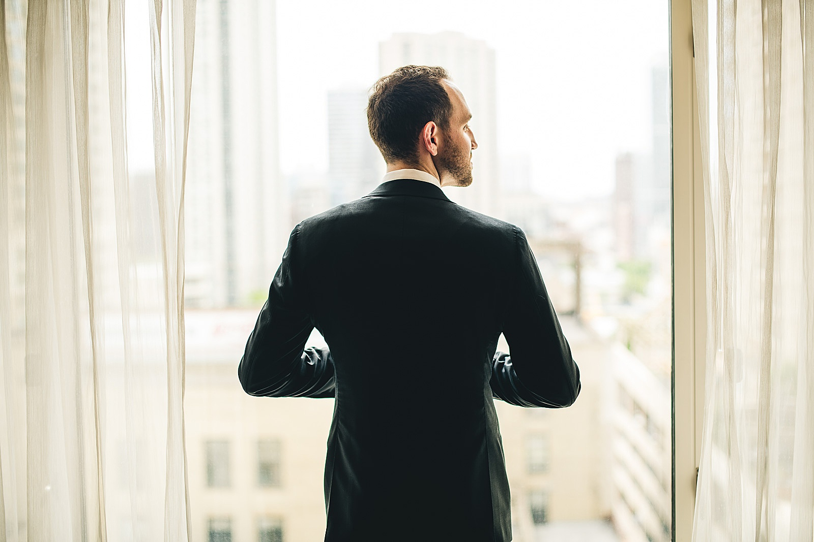 10 groom portrait in chicago peninsula hotel - Susie + Eric's Jewish Wedding at the Peninsula Hotel in Chicago