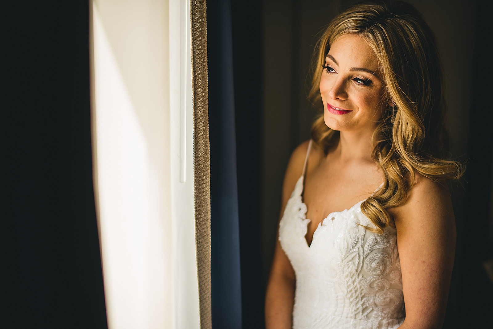 13 bride portrait in window - Susie + Eric's Jewish Wedding at the Peninsula Hotel in Chicago
