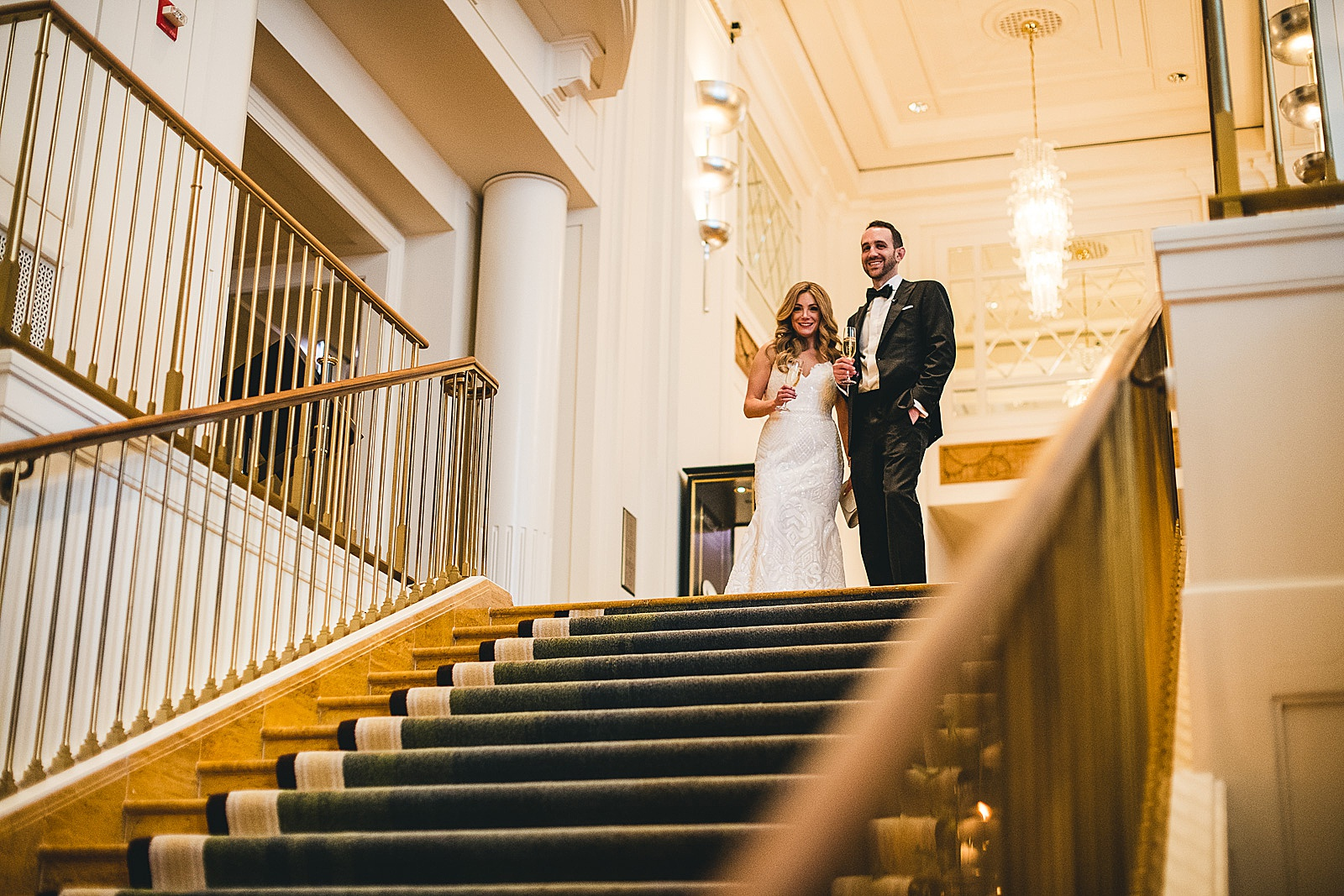 44 bride and groom looking down the stairs - Susie + Eric's Jewish Wedding at the Peninsula Hotel in Chicago
