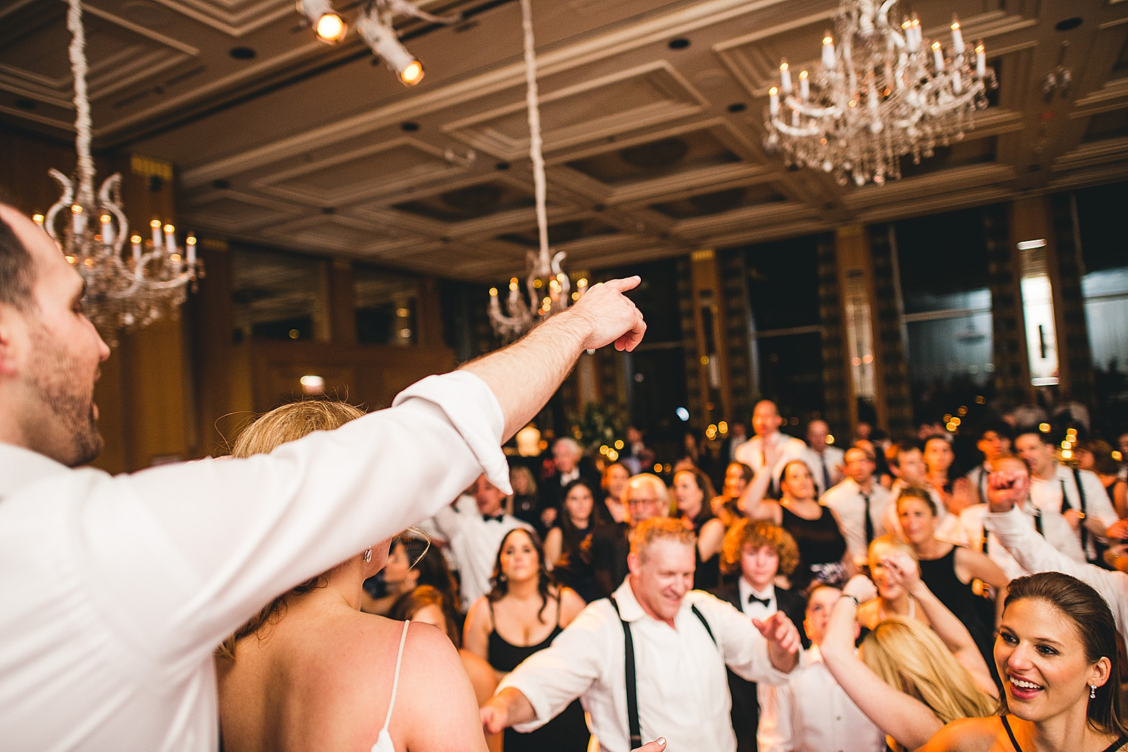 76 pointing into the crowd - Susie + Eric's Jewish Wedding at the Peninsula Hotel in Chicago