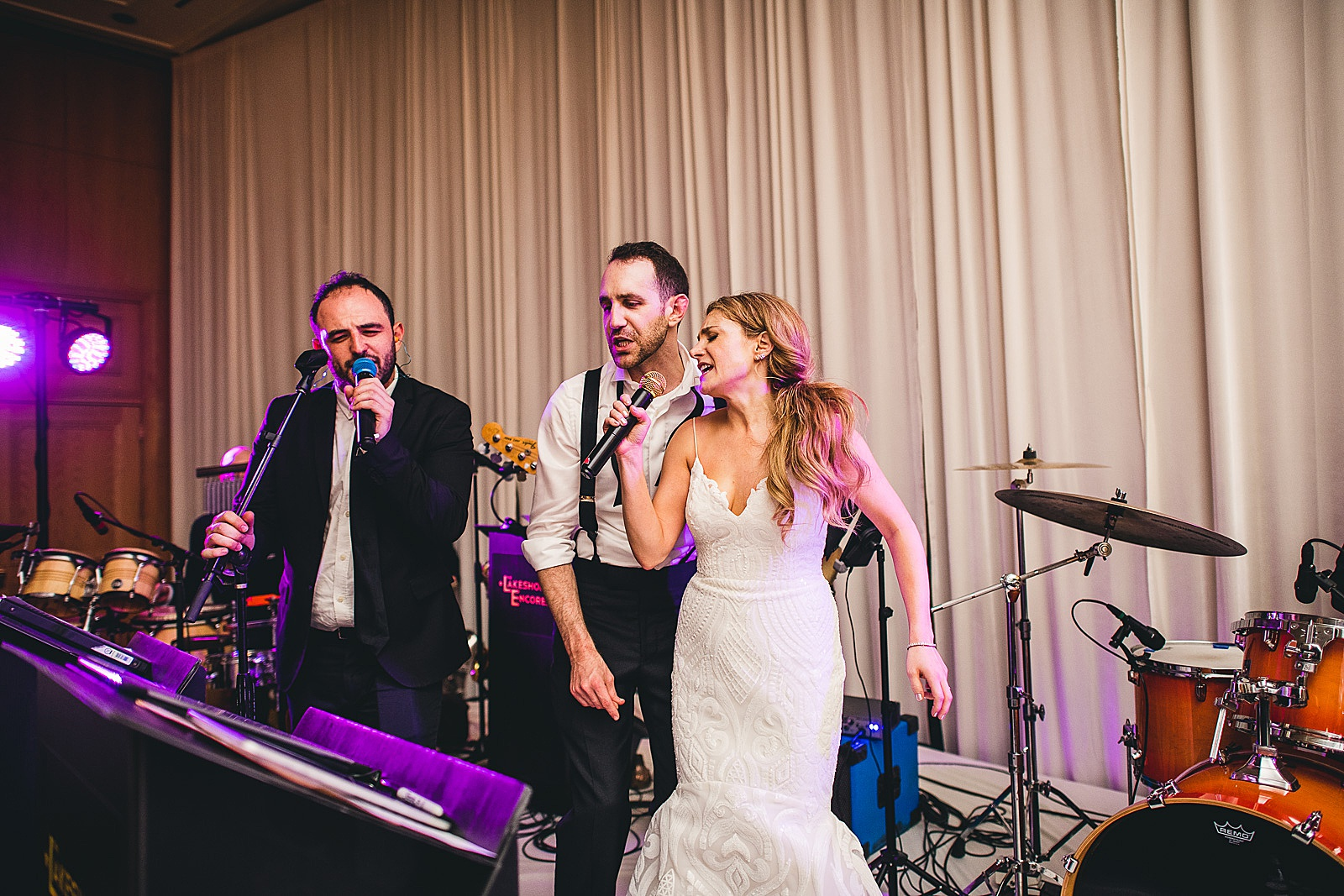 77 bride and groom singing with band - Susie + Eric's Jewish Wedding at the Peninsula Hotel in Chicago